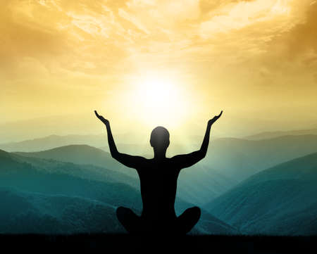 zen: Yoga and meditation. Silhouette of man in the mountain