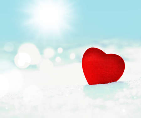 frost winter: red heart on a background of white snow and sky Stock Photo