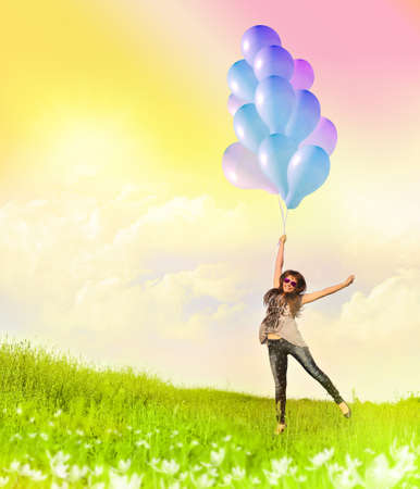 flying woman: Happy young flying woman and colorful balloons.