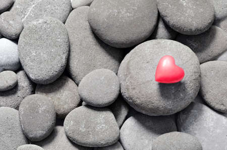 red pebble: Red hearts on pebble stones, still life. Valentines Day background
