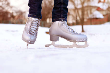 Figure skates on a skating-rink. In the winter outdoors