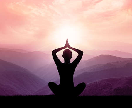 meditation woman: Yoga and meditation. Silhouette of man in the mountain