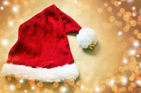 red hat: Santa Claus red hat on color with highlights background