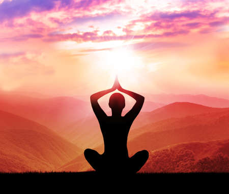 yoga: Yoga and meditation. Silhouette of man in the mountain