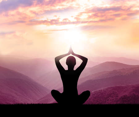 sun: Yoga and meditation. Silhouette of man in the mountain