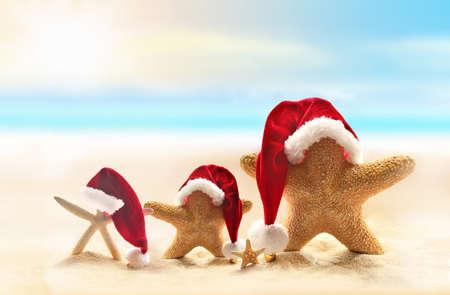 starfish: Starfish on summer beach and Santa hat. Merry Christmas.
