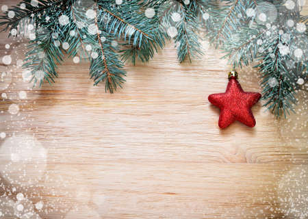 green  pattern: Christmas Border. Tree branches with star and snow on wooden board Stock Photo