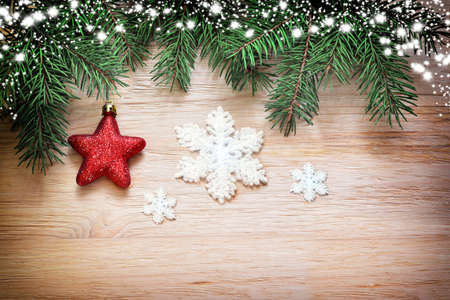 holiday background: Christmas wooden background. Pine and star on the wooden background.
