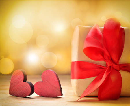 ribbon: Valentines gift box with red hearts on brown background