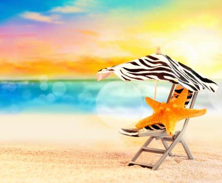 beach umbrella: Beach chair with starfish under umbrella and beautiful beach