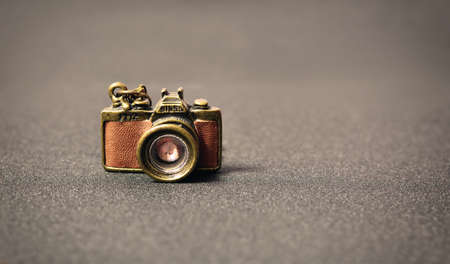 studio model: old vintage decorative small camera on a gray background