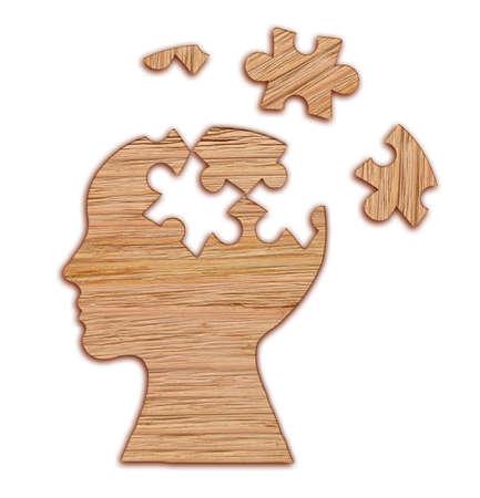 Menselijk hoofdsilhouet met een figuurzaagstuk dat op witte achtergrond, geestelijke gezondheidssymbool wordt verwijderd. Puzzel.