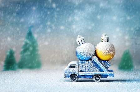 christmas toy: Old antique toy truck carrying christmas balls Stock Photo