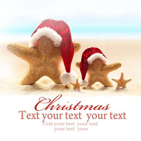 Family of starfish on summer beach and santa hat. Merry Christmas Stock Photo - 63218671