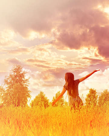 Happy woman enjoying happiness, freedom and nature.