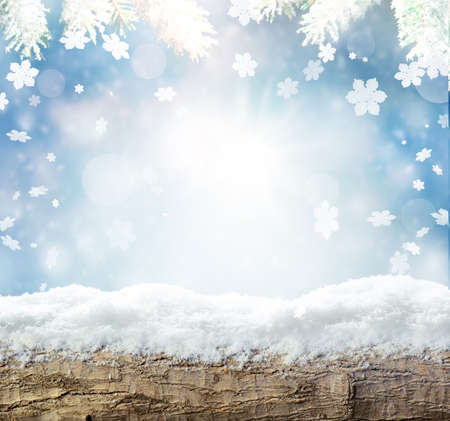 Winter snow bright background. Christmas landscape with wood, snowflakes, snowdrifts and pine branches in the frost Stok Fotoğraf