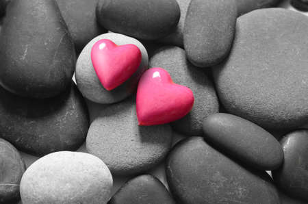 Red hearts on the grey pebbles background. Valentines day.