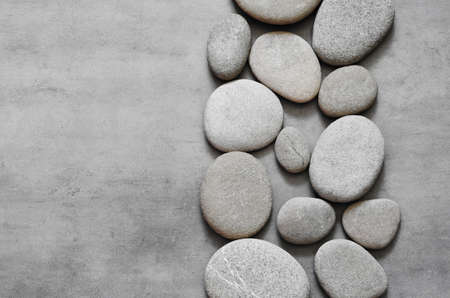 Gray spa stones and grey background. Spa concept.