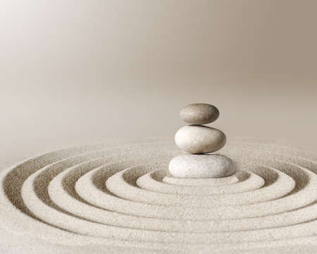 Japanese zen garden meditation stone, concentration and relaxation sand and rock for harmony and balance.