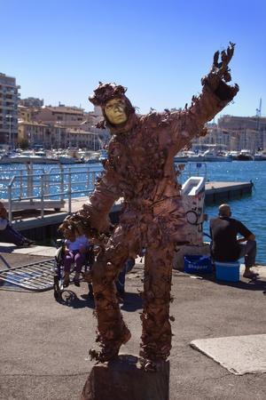 showman: Street showman in Marseille Stock Photo