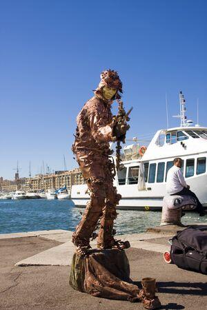 the showman: Street showman in Marseille Stock Photo