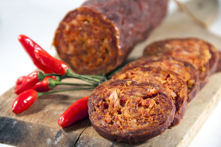 Hungarian homemade paprika salami  sasuage  with chili peppers Stock Photo