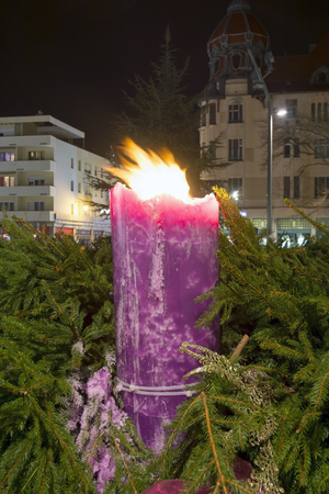 szeged: SZEGED, HUNGARY - DECEMBER 25. 2014 - Big burning candle in Christmas  wreath in the centre of Szeged
