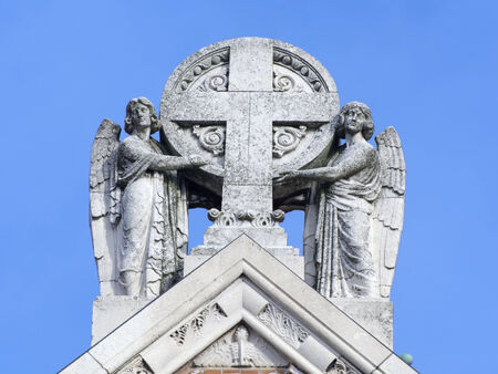 szeged: Stone cross statue with angels on the Cathedral of Szeged Stock Photo