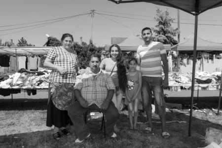 marketeer: DOMBOVAR, HUNGARY - JULY 12. 2015 - Gypsy marketeer family in a rural Sunday marketplace in Hungary