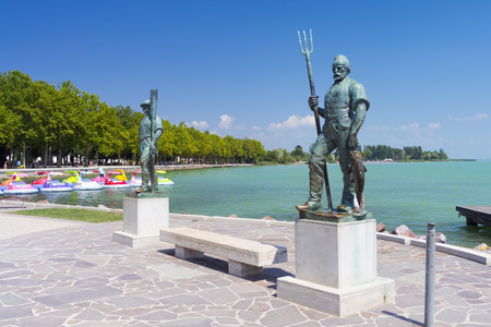 The Fisherman and the Ferryman statues at port of Balatonfured, Hungary