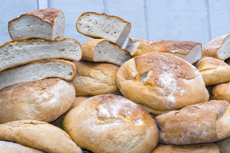 szeged: Pile of leavened bread in a market stall in Szeged, Hungary Stock Photo