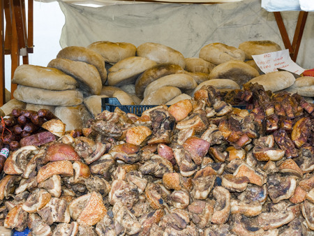 greaves: Bread, greaves, salami and bacon at a market stall in Szeged, Hungary