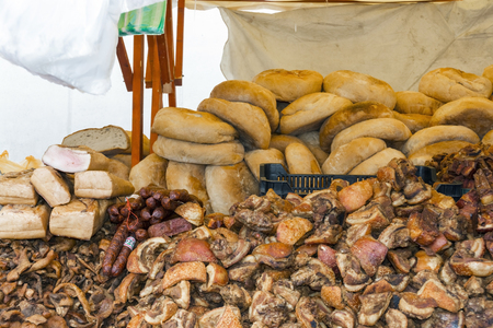 marketeer: Bread, greaves, salami and bacon at a market stall in Szeged, Hungary