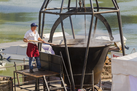 soup kettle: SZEGED, HUNGARY - SEPTEMBER 06. 2015 - Giant kettle of fish soup in the International Tisza Fish Soup Festival in Szeged