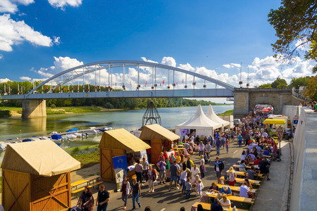 szeged: SZEGED, HUNGARY - SEPTEMBER 06. 2015 - Crowd at the Old Bridge in the International Tisza Fish Soup Festival in Szeged