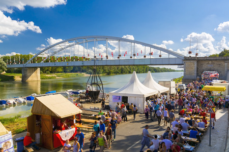SZEGED, HUNGARY - SEPTEMBER 06. 2015 - Crowd and cooking in a giant kettle at the Old Bridge in the International Tisza Fish Soup Festival in Szeged