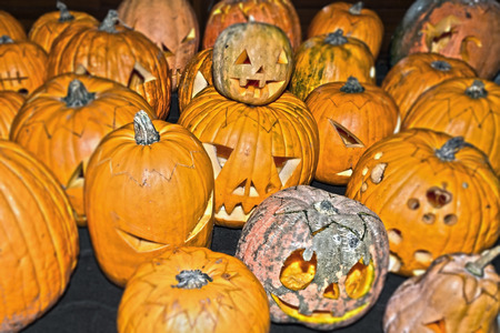 scaring: Lots of carved Halloween pumpinks  together
