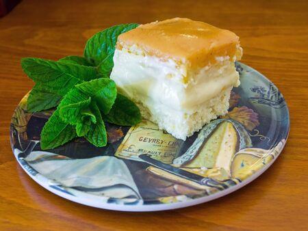 vanilla cake: Vanilla cake with mint leaves on a dish Stock Photo