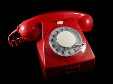 pone: Very old red phone with black background Stock Photo