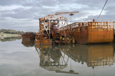 szeged: Old and rusty dredge ship on the harbour of the Tisza River, near Szeged, Hungary