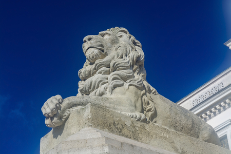 Lion statue at the classicist building of Mora Ferenc Museum in Szeged, Hungary Stock Photo