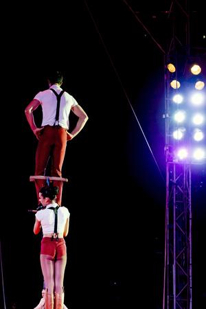 Jumping acrobats at circus