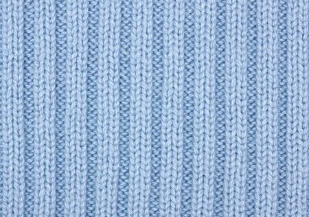 blue cotton ribbed knitting material as background photo