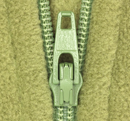 Detail of zipper on green fleece material Stock Photo