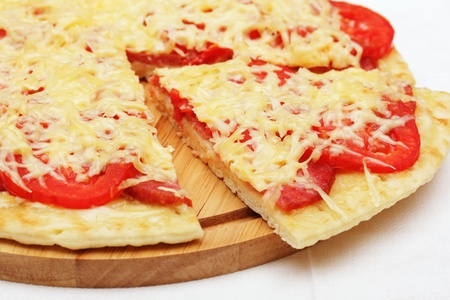 Pizza with a slice removed Stock Photo