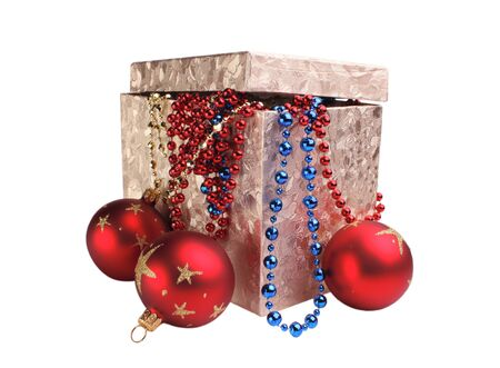 Box and Christmas decorations isolated on white Stock Photo