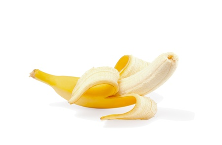 A partly peeled banana on white