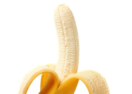 partly: A partly peeled banana isolated on white
