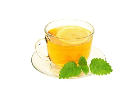 Cup of tea with lemon and lemon balm isolated on  white photo
