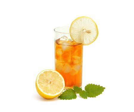 Ice  tea in glass  with lemon and melissa on  white photo